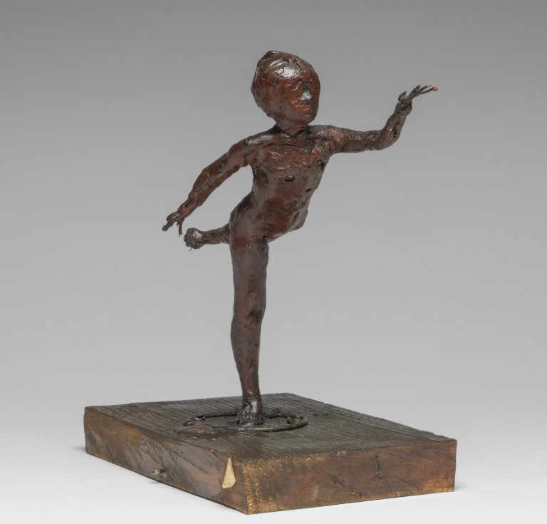 Arabesque over the Right Leg, Left Arm in Front. Degas, Edgar (French, 1834-1917). Red-brown wax, with wire armature which projects as fingers from the hands, and from the lifted foot; attached to rectangular wooden base. The nude dancer stands in an arabesque on her right leg with her left arm extended in front. Height, whole, 23.6 cm, height, wax, 20.6 cm,, circa 1882-1895.